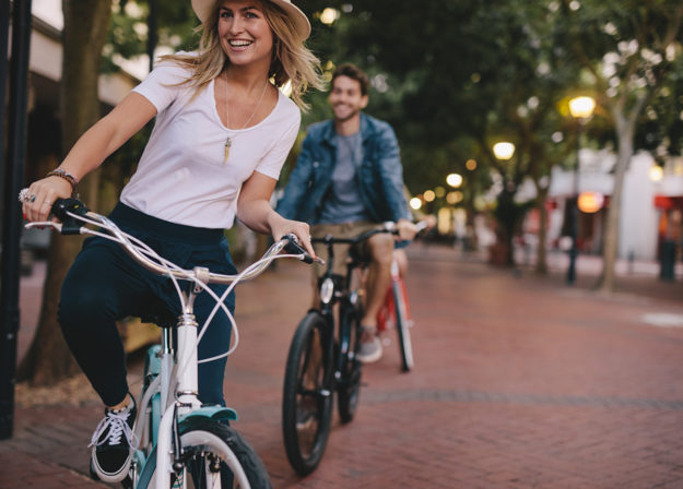 fun sober activities, Woman enjoying cycling outdoors with friends